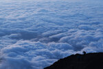 In this Tuesday, Aug. 27, 2019, file photo, a climber stops to take pictures of clouds while climbing towards the summit of Mount Fuji to watch the sunrise, in Japan. (AP Photo/Jae C. Hong, File)