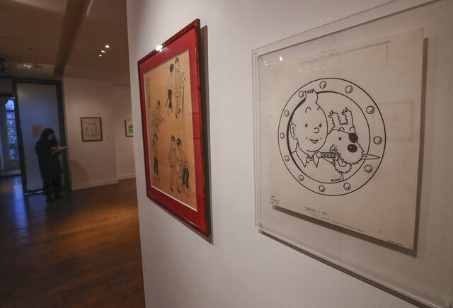 The Chinese inked on paper original of the comic character Tintin and his dog snowy as a pirate made for an advertising and drawn by Belgian creator Herge, is displayed at the Artcurial auction house in Paris, Wednesday, Jan. 13, 2021. The art work with an estimates value of 3000 to 5000 euros (US $ 3650 to 6080), is going on sale Thursday. (AP Photo/Michel Euler)