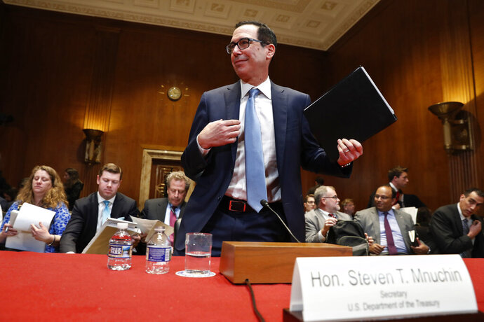 Treasury Secretary Steve Mnuchin gets up after testifying about the budget during a Financial Services and General Government subcommittee hearing, Wednesday May 15, 2019, on Capitol Hill in Washington. (AP Photo/Jacquelyn Martin)