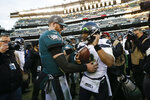 Philadelphia Eagles' Carson Wentz, left, and Seattle Seahawks' Russell Wilson meet after an NFL football game, Sunday, Nov. 24, 2019, in Philadelphia. Seattle won 17-9. (AP Photo/Michael Perez)