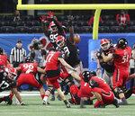 Georgia defensive lineman Jordan Davis, center, blocks the Cincinnati field goal attempt by Cole Smith (17) during the first half in the NCAA college football Peach Bowl game on Friday, Jan. 1, 2021, in Atlanta. (Curtis Compton/Atlanta Journal-Constitution via AP)