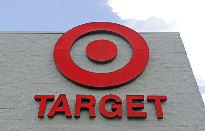 FILE - This June 29, 2016 file photo shows a Target store in Hialeah, Fla. Target shoppers took full advantage of the retailer's pickup and drive up services over the holiday season, climbing 60 percent from a year earlier and making up a quarter of the chain's online sales for the November-December period.  Target Corp. also announced Thursday, Jan. 9, 2019  that sales at stores open at least a year increased 5.7 percent in the period, up from 3.4 percent a year earlier. (AP Photo/Alan Diaz)