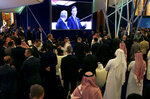 Participants watch White House senior adviser Jared Kushner on a screen during his speech at the Future Investment Initiative forum in Riyadh, Saudi Arabia, Tuesday, Oct. 29, 2019. The long-planned initial public offering of a sliver of Saudi Arabia's state-run oil giant Saudi Aramco will see shares traded on Riyadh's stock exchange in December, a Saudi-owned satellite news channel reported Tuesday as the kingdom's marquee investment forum got underway. (AP Photo/Amr Nabil)