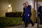 President Donald Trump and first lady Melania Trump leave Christmas Eve service at Family Church Downtown in West Palm Beach, Fla., Tuesday, Dec. 24, 2019. (AP Photo/Andrew Harnik)