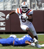 Virginia Tech running back Raheem Blackshear (5) escapes Middle Tennessee safety Reed Blankenship (12) in the first half of an NCAA college football game, Saturday, Sept. 11, 2021, in Blacksburg Va. (AP Photo/Matt Gentry)