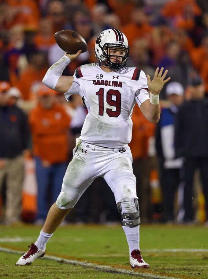 South Carolina quarterback Jake Bentley drops back to pass during the first half of an NCAA college football game against Clemson Saturday, Nov. 24, 2018, in Clemson, S.C. (AP Photo/Richard Shiro)