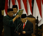 Indonesian Vice President Ma'ruf Amin, right, reads his oath during the inauguration ceremonies for him and President Joko Widodo at the parliament building in Jakarta, Indonesia Sunday, Oct. 20, 2019. Indonesia's popular President Widodo, who rose from poverty and pledged to champion democracy, fight entrenched corruption and modernize the world's most populous Muslim-majority nation is to be sworn in for his final five-year term. AP Photo/Achmad Ibrahim, Pool)