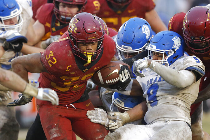 Iowa State running back David Montgomery (32) breaks a tackle by Drake defensive back Alex Rogers (9) during the second half of an NCAA college football game, Saturday, Dec. 1, 2018, in Ames, Iowa. Iowa State won 27-24. (AP Photo/Charlie Neibergall)