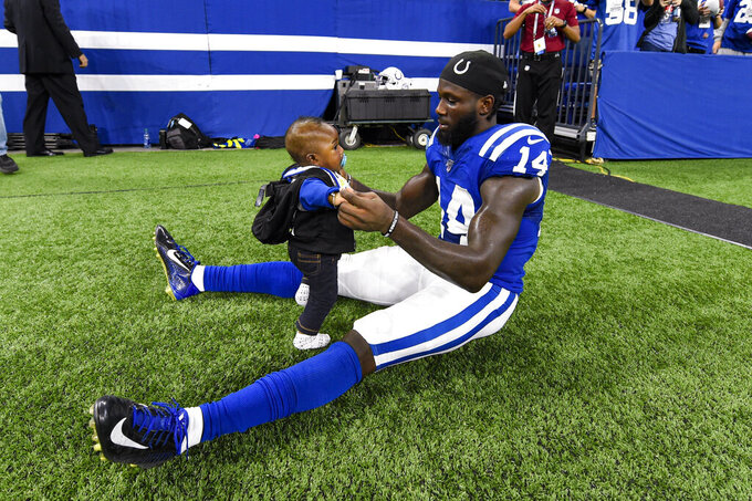 Indianapolis Colts wide receiver Zach Pascal (14) holds his six-month-old son Kairo following an NFL football game against the Oakland Raiders in Indianapolis, Sunday, Sept. 29, 2019. The Raiders defeated the Colts 31-24. (AP Photo/Doug McSchooler)