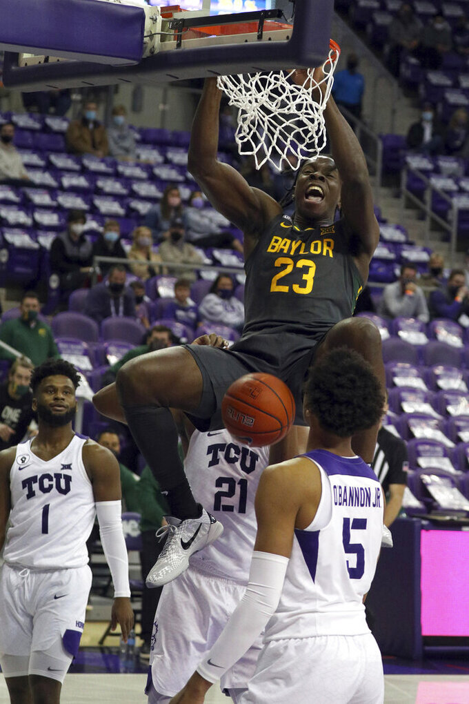 Baylor forward Jonathan Tchamwa Tchatchoua (23) dunks the ball against TCU in the second half of an NCAA college basketball game, Saturday, Jan. 9, 2021, in Fort Worth, Texas. (AP Photo/ Richard W. Rodriguez)