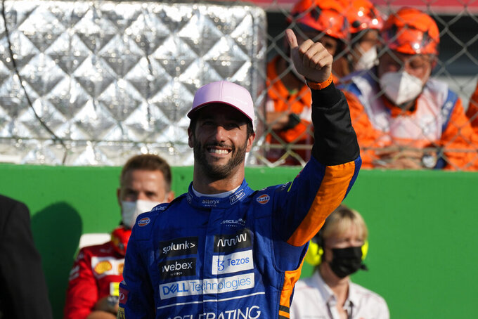 Mclaren driver Daniel Ricciardo of Australia salutes fans after taking third place in the Sprint Race qualifying session at the Monza racetrack, in Monza, Italy , Saturday, Sept.11, 2021. The Formula one race will be held on Sunday. (AP Photo/Luca Bruno)