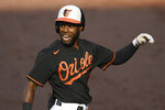 Baltimore Orioles' Cedric Mullins reacts after touching home after his home run during the first inning of the first baseball game of a doubleheader against the New York Yankees, Friday, Sept. 4, 2020, in Baltimore. (AP Photo/Nick Wass)
