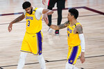 Los Angeles Lakers' Anthony Davis (3) and Danny Green, right, celebrate after a play during the second half of an NBA basketball first round playoff game against the Portland Trail Blazers Saturday, Aug. 29, 2020, in Lake Buena Vista, Fla. The Lakers won 131-122 to win the series 4-1. (AP Photo/Ashley Landis)