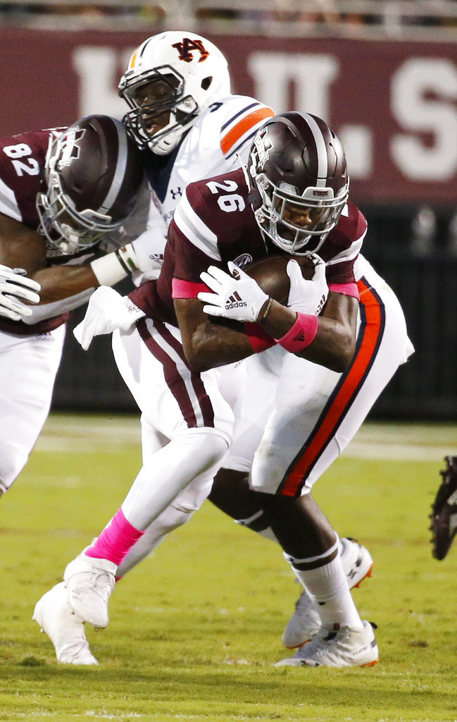 Mississippi State running back Aeris Williams (26) runs past an Auburn defender during the first half of their NCAA college football game in Starkville, Miss., Saturday, Oct. 6 2018. (AP Photo/Rogelio V. Solis)