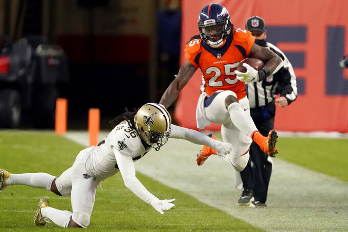 New Orleans Saints free safety D.J. Swearinger (36) knocks Denver Broncos running back Melvin Gordon (25) out of bounds during the second half of an NFL football game, Sunday, Nov. 29, 2020, in Denver. (AP Photo/Jack Dempsey)