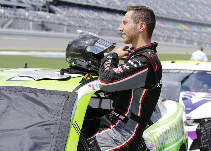 Kaz Grala gets in the No. 3 car before a NASCAR Cup Series auto race at Daytona International Speedway, Sunday, Aug. 16, 2020, in Daytona Beach, Fla. Grala is filling in for Austin Dillion who tested positive for Covid-19. (AP Photo/Terry Renna)