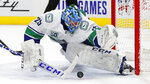 Vancouver Canucks goaltender Jacob Markstrom stops a Detroit Red Wings shot during the second period of an NHL hockey game Tuesday, Oct. 22, 2019, in Detroit. (AP Photo/Paul Sancya)