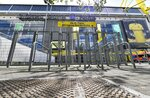 The supporter's entrance of the Signal Iduna Park, Germany's biggest stadium of Borussia Dortmund, is closed in Dortmund, Germany, Thursday, May 14, 2020. Bundesliga will now restart on May 16, 2020 when Borussia Dortmund will play the derby against FC Schalke 04 at home without spectators due to the coronavirus outbreak. (AP Photo/Martin Meissner)