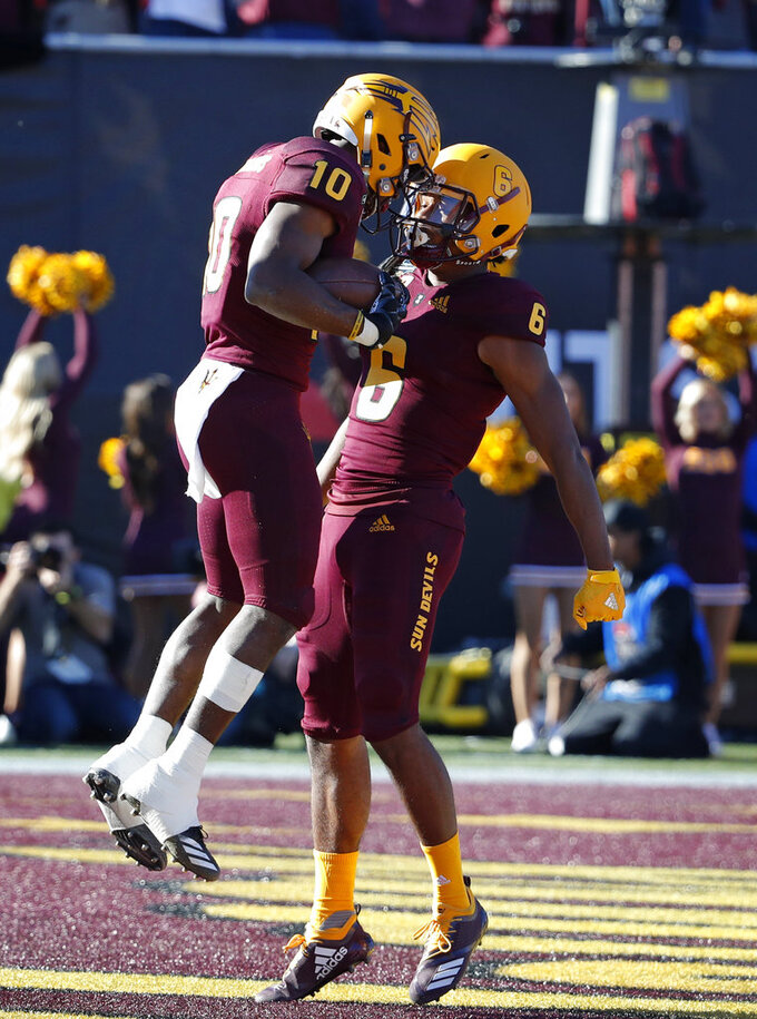 Arizona State wide receiver Geordon Porter, right, celebrates after wide receiver Kyle Williams, left, scored a touchdown against Fresno State during the first half of the Las Vegas Bowl NCAA college football game, Saturday, Dec. 15, 2018, in Las Vegas. (AP Photo/John Locher)