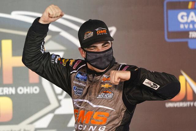 Sam Mayer celebrates in Victory Lane after winning the NASCAR Truck Series auto race, Thursday Sept. 17, 2020, in Bristol, Tenn. (AP Photo/Steve Helber)