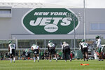 New York Jets wide receiver's Matt Cole (19), Manasseh Bailey (3), Jeff Smith (16) and D.J. Montgomery (14) line up to run a drill during NFL football practice Wednesday, July 28, 2021, in Florham Park, N.J. (AP Photo/Adam Hunger)