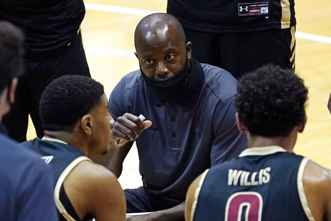College of Charleston coach Earl Grant speaks with his players during the first half of an NCAA college basketball game against North Carolina in Chapel Hill, N.C., Wednesday, Nov. 25, 2020. (AP Photo/Gerry Broome)