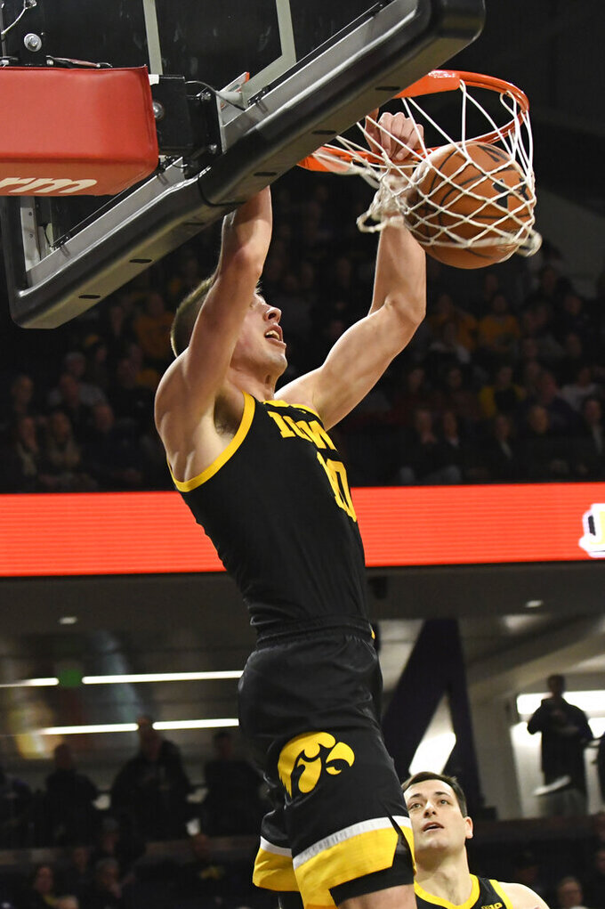 Iowa guard Joe Wieskamp dunks against Northwestern during the first half of an NCAA college basketball game Tuesday, Jan. 14, 2020, in Evanston, Ill. (AP Photo/David Banks)