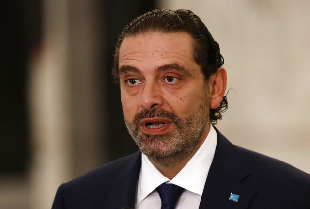 Lebanese Prime Minister-Designate Saad Hariri speaks to journalists at the Presidential Palace in Baabda, east of Beirut, Lebanon, Thursday, Oct, 22, 2020. Lebanon's president Michel Aoun asked former premier Saad Hariri to form the country's next government Thursday after he secured enough votes from lawmakers - bringing back an old name to lead the country out of its dire political and economic crises. (AP Photo/Hussein Malla)