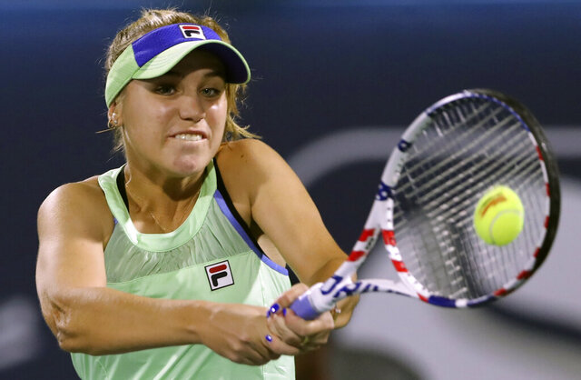 FILE - In this Feb. 18, 2020, file photo, Sofia Kenin returns the ball to Kazakhstan's Elena Rybakina during a match of the Dubai Duty Free Tennis Championship in Dubai, United Arab Emirates. If World TeamTennis gets its way, Grand Slam champions Sofia Kenin and Sloane Stephens could be among the first tennis players to compete in front of fans after the coronavirus pandemic prompted lockdowns around the globe. WTT said Tuesday, May 26, 2020, it is planning to allow up to 500 spectators at each of its outdoor matches during a three-week season from July 12 to Aug. 2 at a resort in West Virginia.(AP Photo/Kamran Jebreili, File)