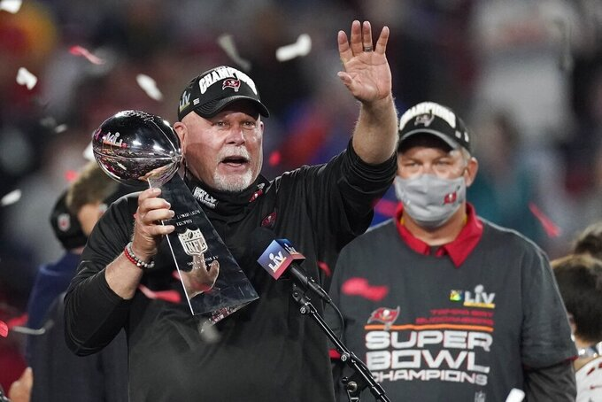 Tampa Bay Buccaneers head coach Bruce Arians holds up the Vince Lombardi trophy after defeating the Kansas City Chiefs in the NFL Super Bowl 55 football game Sunday, Feb. 7, 2021, in Tampa, Fla. The Buccaneers defeated the Chiefs 31-9 to win the Super Bowl. (AP Photo/Ashley Landis)