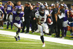 Denver Broncos cornerback Pat Surtain II (2) runs from Minnesota Vikings wide receiver Ihmir Smith-Marsette (15) while returning an interception 30-yards for a touchdown during the first half of an NFL preseason football game, Saturday, Aug. 14, 2021, in Minneapolis. (AP Photo/Bruce Kluckhohn)