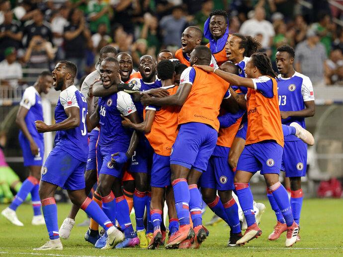 Haiti celebrates a 3-2 win over Canada in a CONCACAF Gold Cup soccer quarterfinal Saturday, June 29, 2019, in Houston. (AP Photo/Michael Wyke)