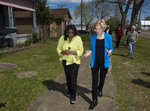 Rep. Terri Sewell and Democratic presidential candidate Sen. Elizabeth Warren, D-Mass., walk through a neighborhood in Selma, Ala., on Tuesday, March 19, 2019. (Jake Crandall/The Montgomery Advertiser via AP)