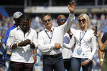 FILE — In this Sept. 15, 2019, file photo, former Tennessee Titans head coach Jeff Fisher waves to the crowd during a ceremony at an NFL football game between the Titans and the Indianapolis Colts in Nashville, Tenn. The Titans announced July 14, 2021, that Fisher, former Houston Oiler head coach Bum Phillips, and former Titans general manager Floyd Reese will be the newest members of the Tennessee Titans' ring of honor. (AP Photo/James Kenney, File)