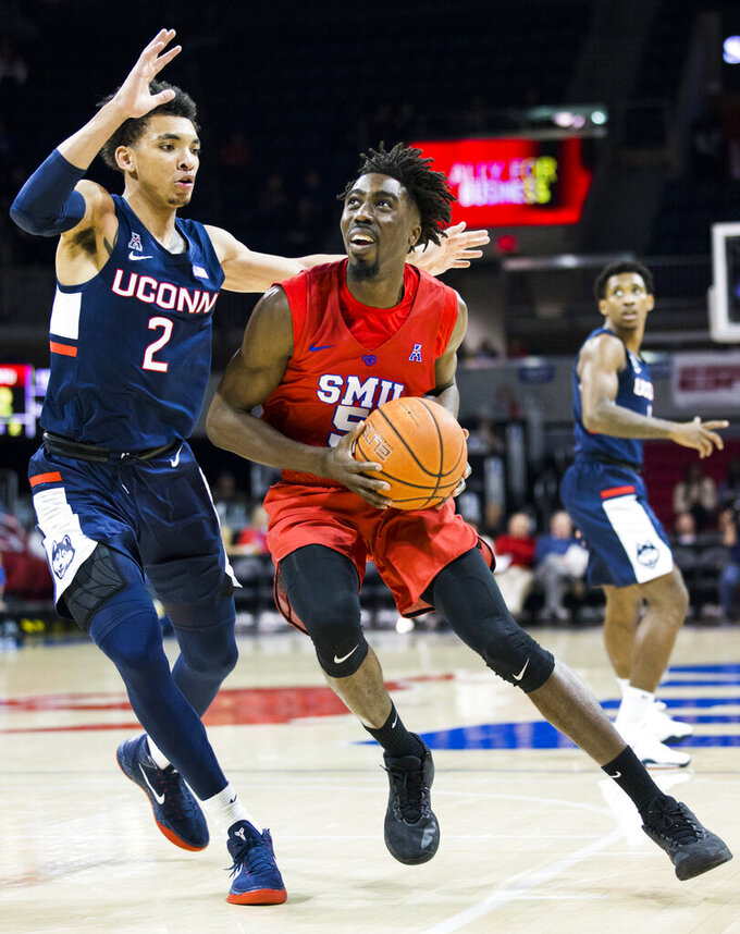 SMU guard Emmanuel Bandoumel (5) looks for a shot around Connecticut guard James Bouknight (2) during the first half of an NCAA college basketball game Wednesday, Feb. 12, 2020, in Dallas. (Ashley Landis/The Dallas Morning News via AP)