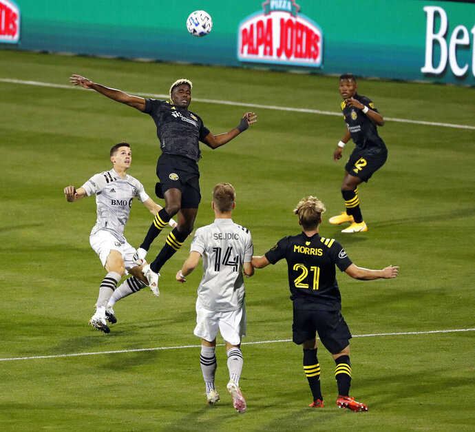 Columbus Crew forward Gyasi Zardes (11) goes up for a header against Montreal Impact defender Jukka Raitala, left, during the first half of an MLS soccer match in Columbus, Ohio, Wednesday, Oct. 7, 2020. (Kyle Robertson/The Columbus Dispatch via AP)