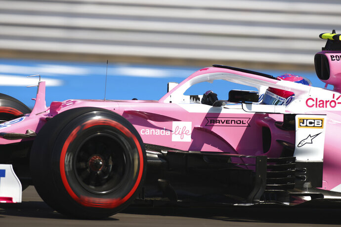 Racing Point driver Lance Stroll of Canada steers his car during the first practice session for the British Formula One Grand Prix at the Silverstone circuit in Silverstone, England, Friday, July 31, 2020. The British Formula One Grand Prix race will be held on Sunday. (Bryn Lennon/Pool via AP)