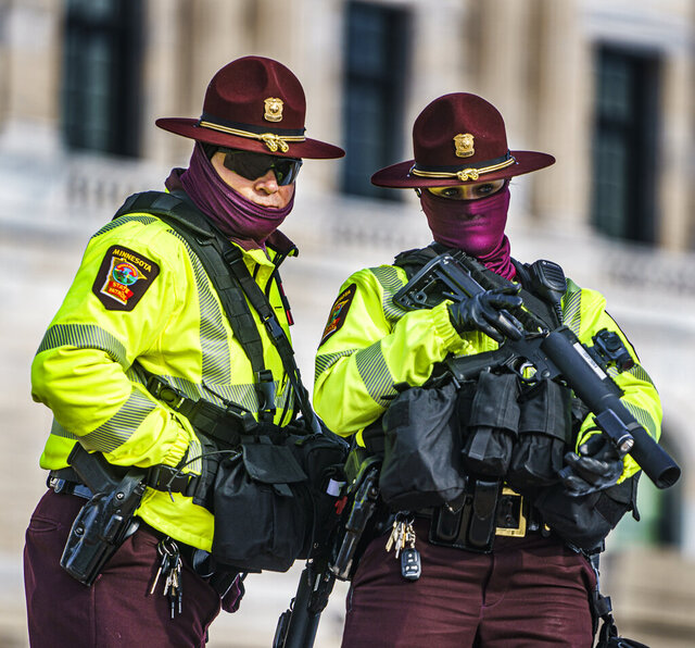 Capitol security watch protesters during a rally in support of President Donald Trump on the steps of the Minnesota State Capitol on Wednesday, Jan. 6, 2021 in St. Paul, Minn.  (Richard Tsong-Taatarii/Star Tribune via AP)