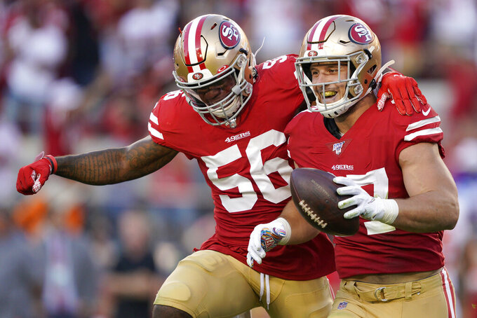 San Francisco 49ers defensive end Nick Bosa, right, celebrates with middle linebacker Kwon Alexander (56) after recovering a fumble by Cleveland Browns quarterback Baker Mayfield during the first half of an NFL football game in Santa Clara, Calif., Monday, Oct. 7, 2019. (AP Photo/Tony Avelar)