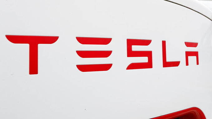 FILE - This Wednesday, March 18, 2020, file photo, shows a Tesla charging station for automobiles in Port Huron, Mich. Tesla's sales of its increasingly popular electric cars got off to a fast start in the year, even though the company had to slam the brakes along with other major automakers in March 2020 because of worldwide efforts to contain the worst pandemic in a century. (AP Photo/Paul Sancya, File)