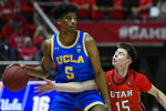 UCLA guard Chris Smith (5) attempts to dribble around Utah guard Rylan Jones (15) during the first half of an NCAA college basketball game Thursday, Feb. 20, 2020, in Salt Lake City. (AP Photo/Alex Goodlett)