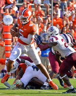 Clemson quarterback D. J. Uiagalelei (5) runs for a touchdown in the first half of an NCAA college football game against South Carolina State on Saturday, Sept. 11, 2021, in Clemson, S.C. (AP Photo/Edward M. Pio Roda)