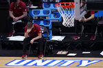 Arkansas head coach Eric Musselman sits on the bench during the second half of an Elite 8 game against Baylor in the NCAA men's college basketball tournament at Lucas Oil Stadium, Monday, March 29, 2021, in Indianapolis. (AP Photo/Darron Cummings)
