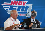 Dr. Terry Trammell, IndyCar safety consultant, left, describes the I-Portal Portable Assessment System being worn by J. Howison Schroeder, president and chief executive officer of Neuro Kinetics, during a press conference before the start of practice for the IndyCar Indianapolis 500 auto race at Indianapolis Motor Speedway in Indianapolis, Thursday, May 17, 2018. The system is being used in the sanctioning body's concussion evaluation protocol. (AP Photo/Michael Conroy)