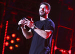 FILE - In this June 9, 2017 file photo, Sam Hunt performs at the 2017 CMA Music Festival in Nashville, Tenn. Hunt's