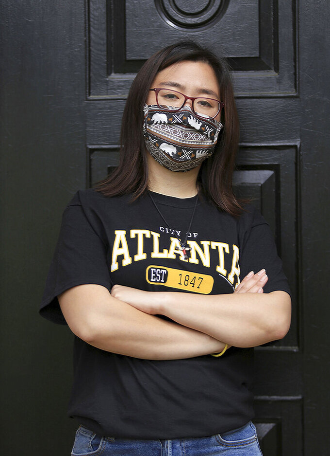 Claire Xu, poses for a photo, Friday, April 9, 2021, in Decatur, Ga., Xu was propelled into action following the mass fatal shootings of eight people, six of them Asian women, at a Georgia massage businesses in March. She organized a massive rally condemning violence against Asian Americans that drew support from a broad group of activists, elected officials and community members. But her own parents were opposed. (AP Photo/Akili-Casundria Ramsess)