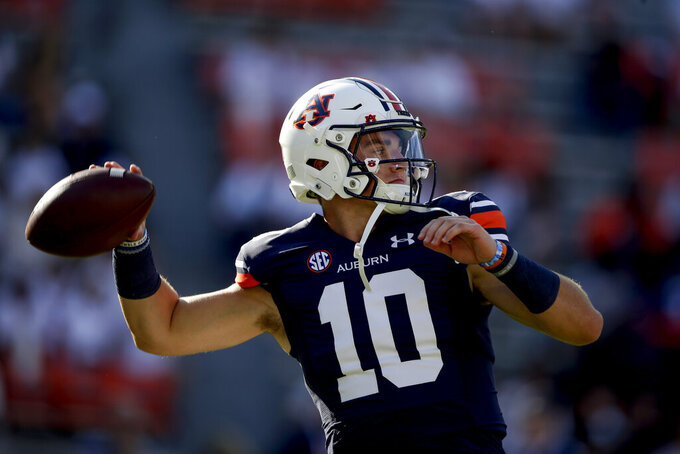 Auburn quarterback Bo Nix (10) warms up for the team's NCAA college football game against Akron on Saturday, Sept. 4, 2021, in Auburn, Ala. (Photo/Butch Dill)