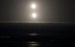 The SpaceX Falcon heavy rocket boosters return to land after a successful launch from the Kennedy Space Center in Cape Canaveral, Fla., early Tuesday, June 25, 2019. The Falcon rocket has a payload military and scientific research satellites. (AP Photo/John Raoux)