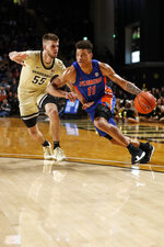Florida forward Keyontae Johnson (11) drives past Vanderbilt forward Oton Jankovic (55) during an NCAA college basketball game Saturday, Feb. 1, 2020, in Nashville, Tenn. (Wade Payne/The Tennessean via AP)
