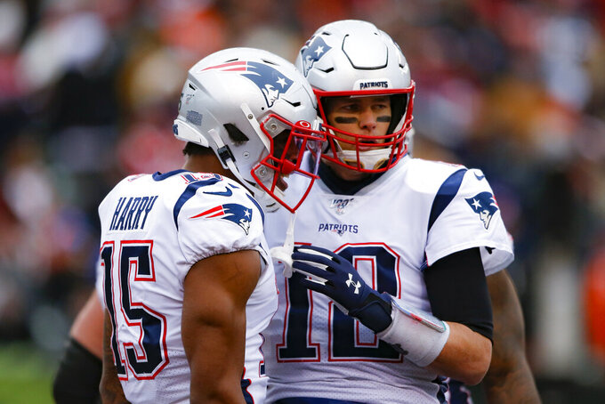 New England Patriots wide receiver N'Keal Harry (15) celebrates his touchdown with quarterback Tom Brady (12) in the second half of an NFL football game against the Cincinnati Bengals, Sunday, Dec. 15, 2019, in Cincinnati. (AP Photo/Gary Landers)